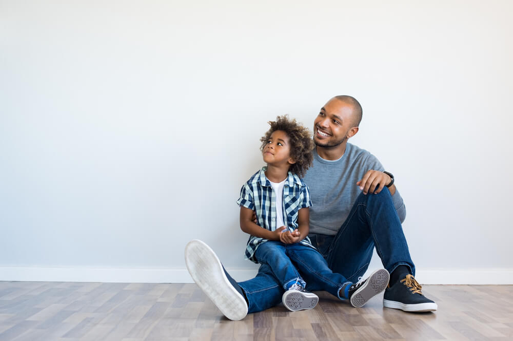 father with his son sitting on the floor